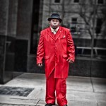 photo of man in red suit