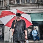 photo of man with umbrella