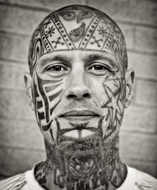 Man-with-tattoos-covering-head