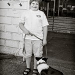 Boy with his dog before judging: At the fair