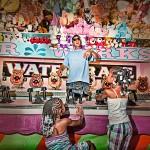 Little girls at the squirtgun booth at the fair