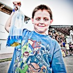 Boy with prize goldfish