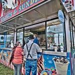 Man and woman deciding whether shake or sundaes at the fair