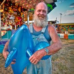 Man with prizes at the Montgomery County Fair