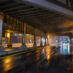 Night photo of road under bridge on a wet, snowy night. (S. Patterson Blvd, Dayton, Ohio)
