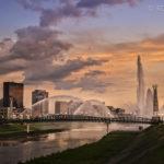 Golden skyline with fountains & bridge