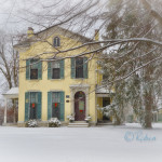 Winter scene of old home in the snow
