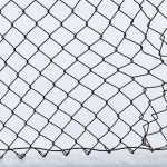 Winter abstract in black and white of chainlink fence