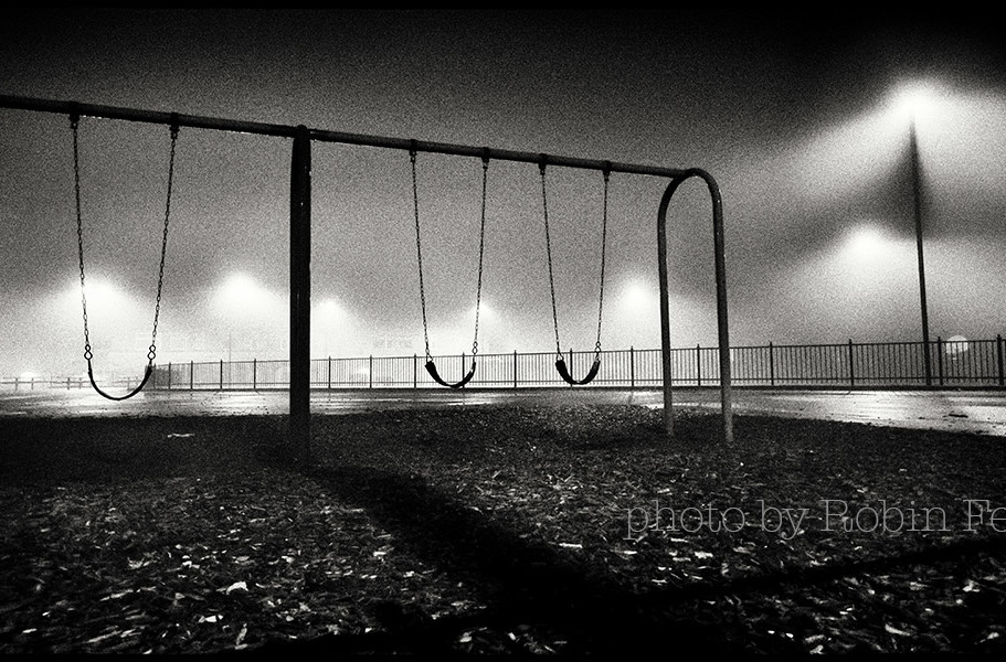 Playground on foggy night