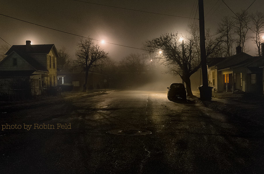 Street scene on foggy night